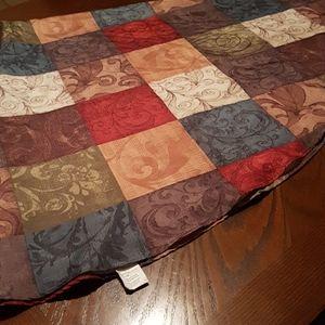 Round multi colored table cloth
